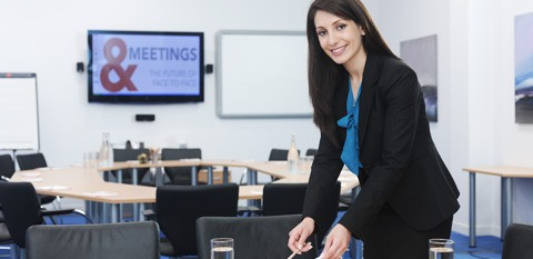Business Woman in Meeting Room Picking Something up