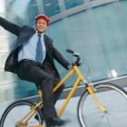 Business man biking to work