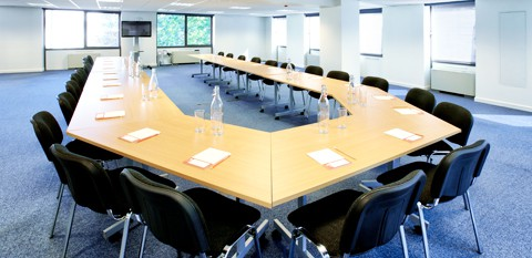 Modern Meeting Room with a Large U Shaped Table