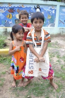 Cambodian children with an &Meetings bag