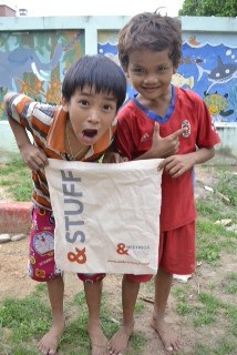 Cambodian children Holding &Meetings bag up