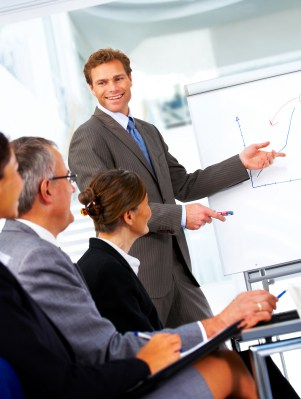 Businessman Presenting a Graph in a Meeting