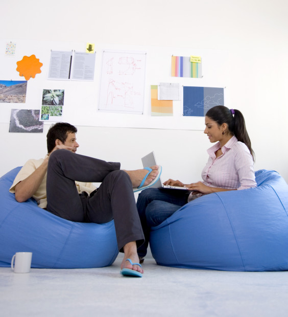 Man and a Woman Having a Casual Meeting on Beanbags