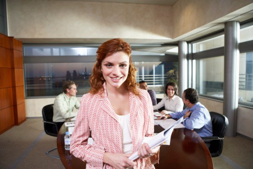 Red Haired Business Woman in a Meeting