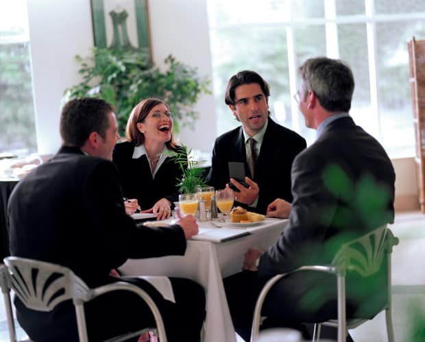 Business People at a Table in a Restaurant Laughing