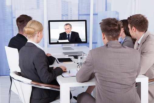 Business People on a Video Call to a Businessman