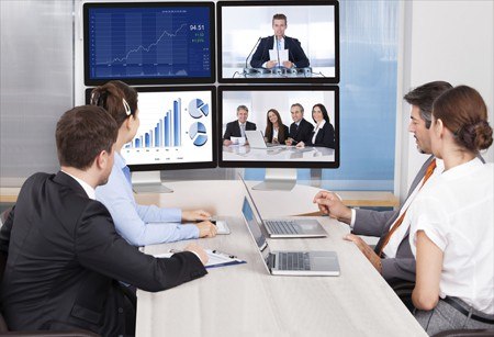 Business People in a Video Conference Whilst Looking at Graphs