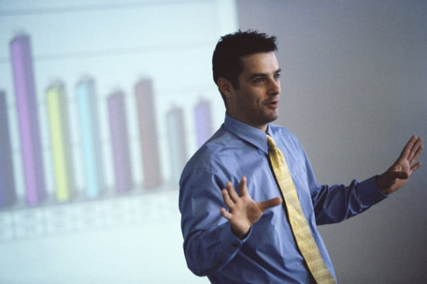 Businessman Giving Presentation with his Hands up