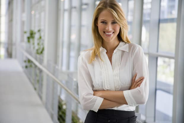 Young Business Woman Smiling with her Arms Crossed