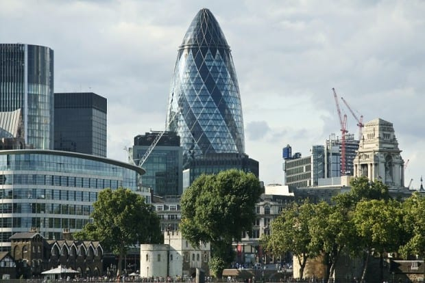 Picture of the Gherkin Surrounded by Other Buildings in London