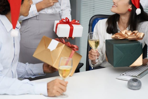 Business Colleagues Giving Each Other Gifts