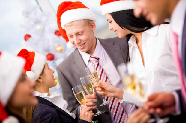 Business People with Drinks and Festive Hats