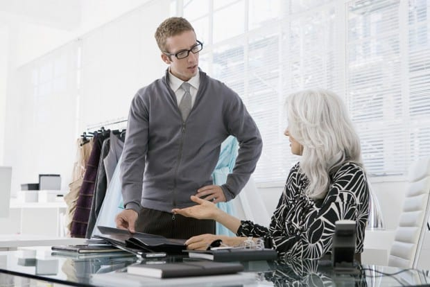 Man Discussing Something With a Woman in a Modern Office