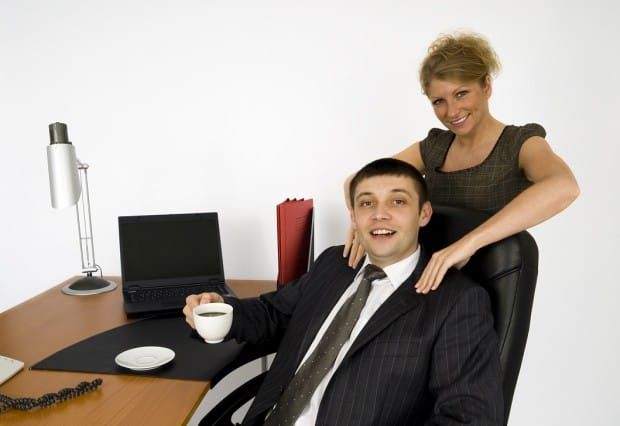 Woman Giving Businessman a Massage