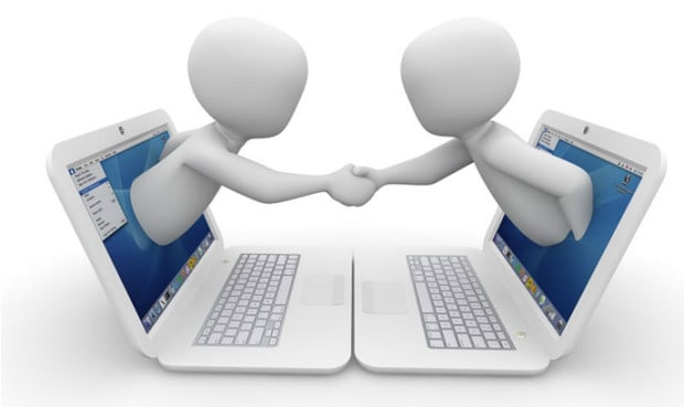 Two People Shaped Figures Reaching out a Computer Screen and Shaking Hands