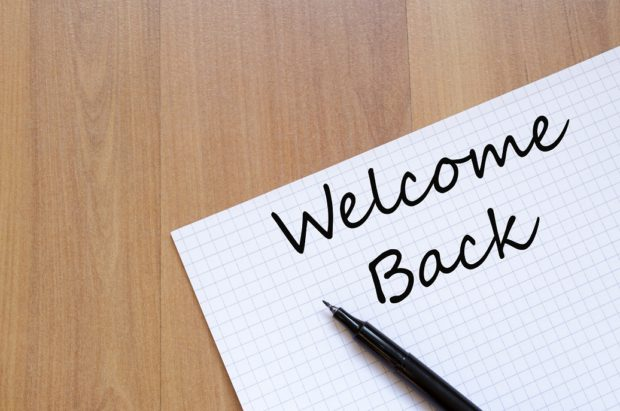The Words 'Welcome Back' Written on a Piece of Paper
