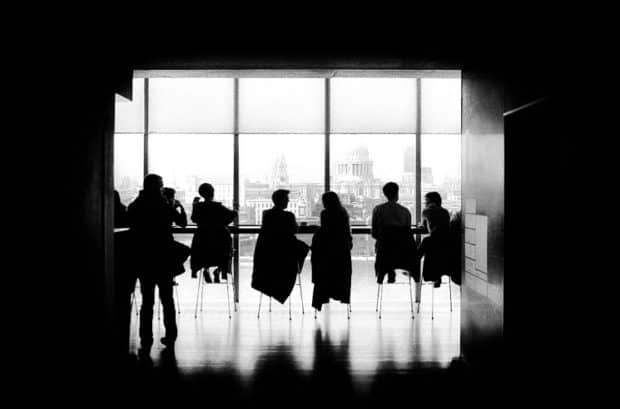 Silhouettes of People Having a Meeting