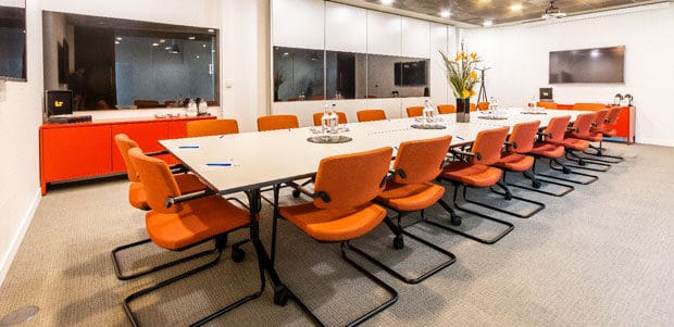 Large Brightly Coloured Meeting Room with a Long Table