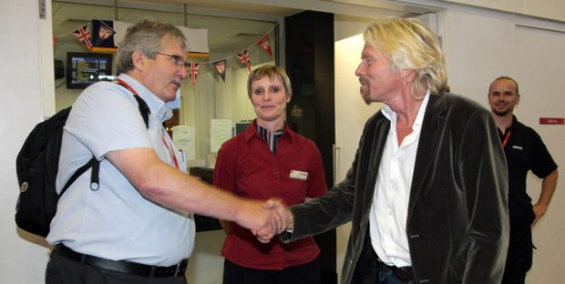 Richard Branson Shaking Hands With a man