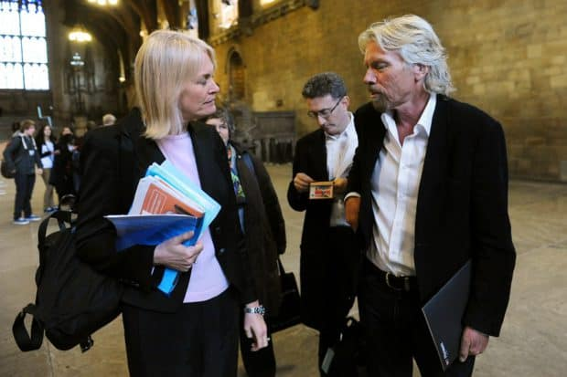 Richard Branson Talking to a Woman
