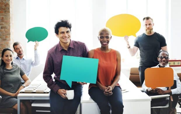 Business Team Holding Speech Bubble Signs