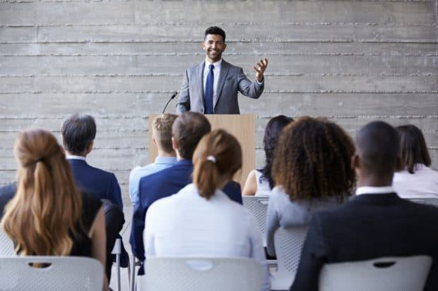 Businessman Speaking In-front of a Group of People
