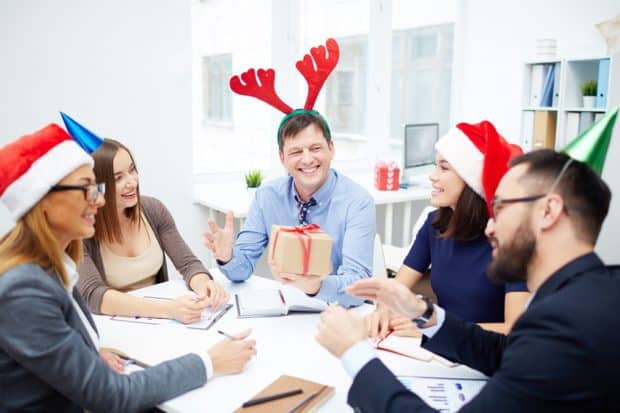 Business People With Festive Hats Smiling