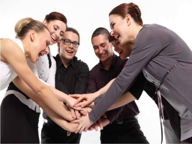 A Group of Business People Joining Hands