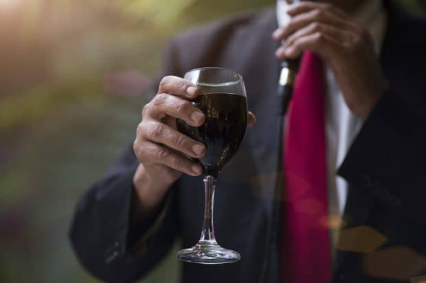 A Business Man Holding a Glass of Wine