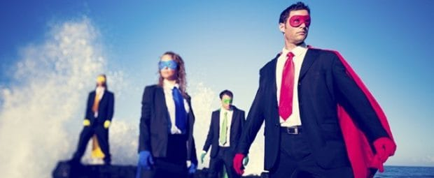 Business People Dressed as Super Heros