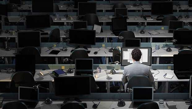 Man working in darkened office
