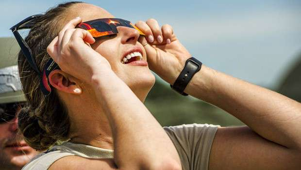 Woman watching a solar eclipse